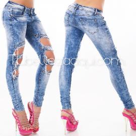 Jeans push up descoloridos con aberturas